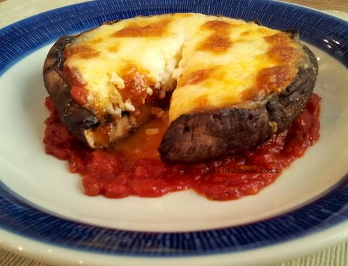 This giant Stuffed Portobello mushroom recipe is literally blowing our mind! Look at all that saucy, cheesy goodness on one plate. Like a deep dish pizza…without the crust!