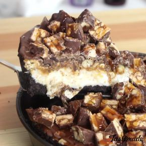 An ice cream, caramel, peanut, and chocolate pie topped with chunks of your favorite chocolate bar. — oh, my!
