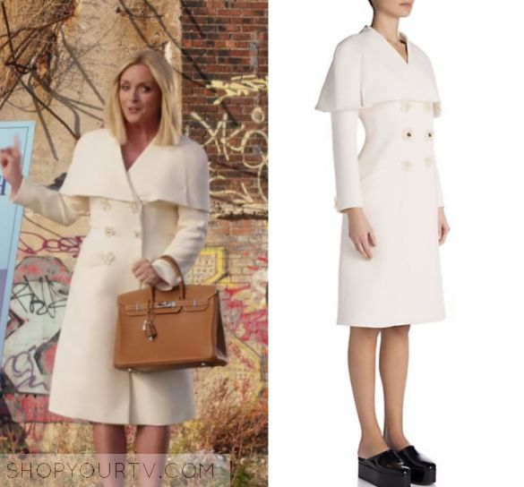 "Unbreakable Kimmy Schmidt: Season 3 Episode 2 Jacqueline's Flower Button Coat | Shop Your TV by Kirsty0 Comments  Jacqueline Voorhees (Jane Krakowski) wears this white double breasted coat with floral buttons in this episode of Unbreakable Kimmy Schmidt, ""Kimmy's Roommate Lemonade!"".  It is the Fendi Floral Double-Breasted Capelet Coat."