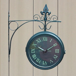 NEW! Double Sided Outdoor Clock - Victorian styling meets modern functionality! Elegant outdoor clock brings a traditional feel to your outdoor abode by day, and glow-in-the-dark face displays the time by night. $39.98 CAD