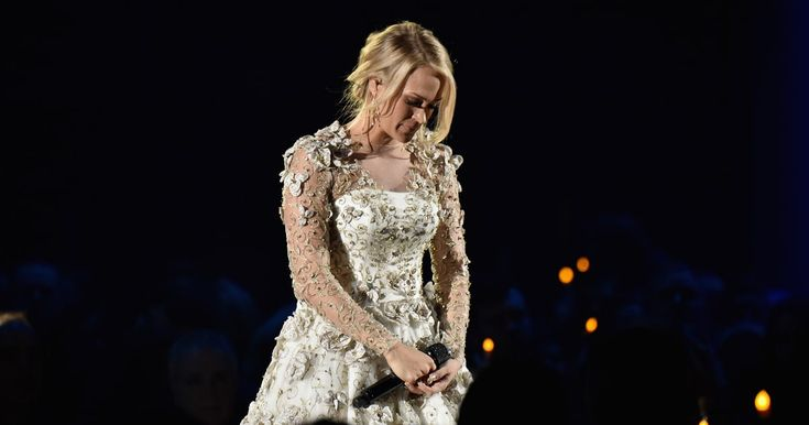 See Carrie Underwood's Tribute to Las Vegas Victims at CMA Awards      Carrie Underwood pays tribute to victims of the Las Vegas shooting during the In Memoriam segment at the CMA Awards. http://www.rollingstone.com/country/news/see-carrie-underwoods-tribute-to-las-vegas-at-cma-awards-w511275?utm_campaign=crowdfire&utm_content=crowdfire&utm_medium=social&utm_source=pinterest