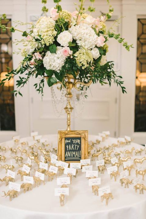 """Guests were told to """"Find Your Party Animal"""" on this escort card table ~ http://www.stylemepretty.com/washington-dc-weddings/2016/03/07/classic-black-white-d-c-wedding-ballroom-wedding-with-pops-of-pink/"""