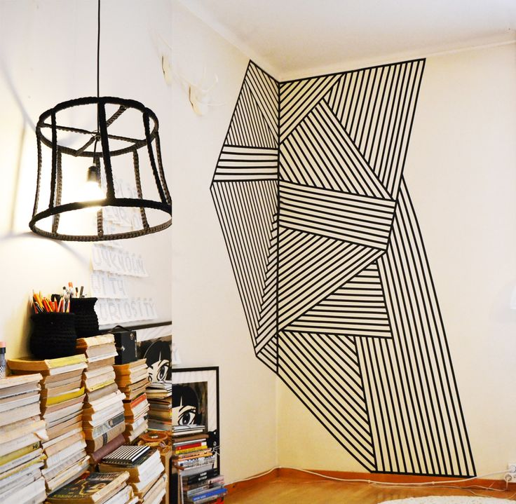Wall decoration made with black plastic tape, size 200x260cm. Wire lamp made from recycled lampshade, crocheted cover. Crocheted small ming ...