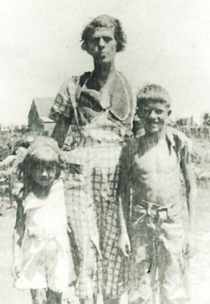Lillian Gordy Carter with her son Jimmy Carter and daughter Gloria. 1930's. Georgia.