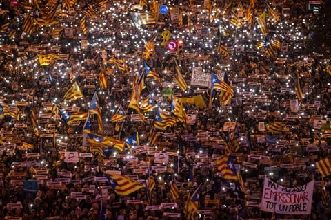 Barcelona, SpainPeople march to protest against the prison detentions of the ousted Catalan government during a rally for Catalan independence