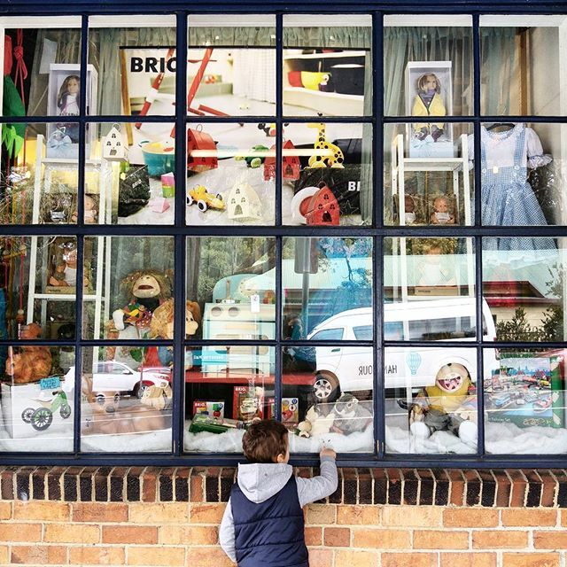 Nothing draws the attention of a child and the child within like a toy store window. Geppettos Workshop