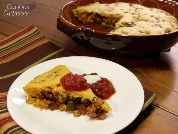 Tamale Pie with Beans and Squash via Curious Cuisiniere