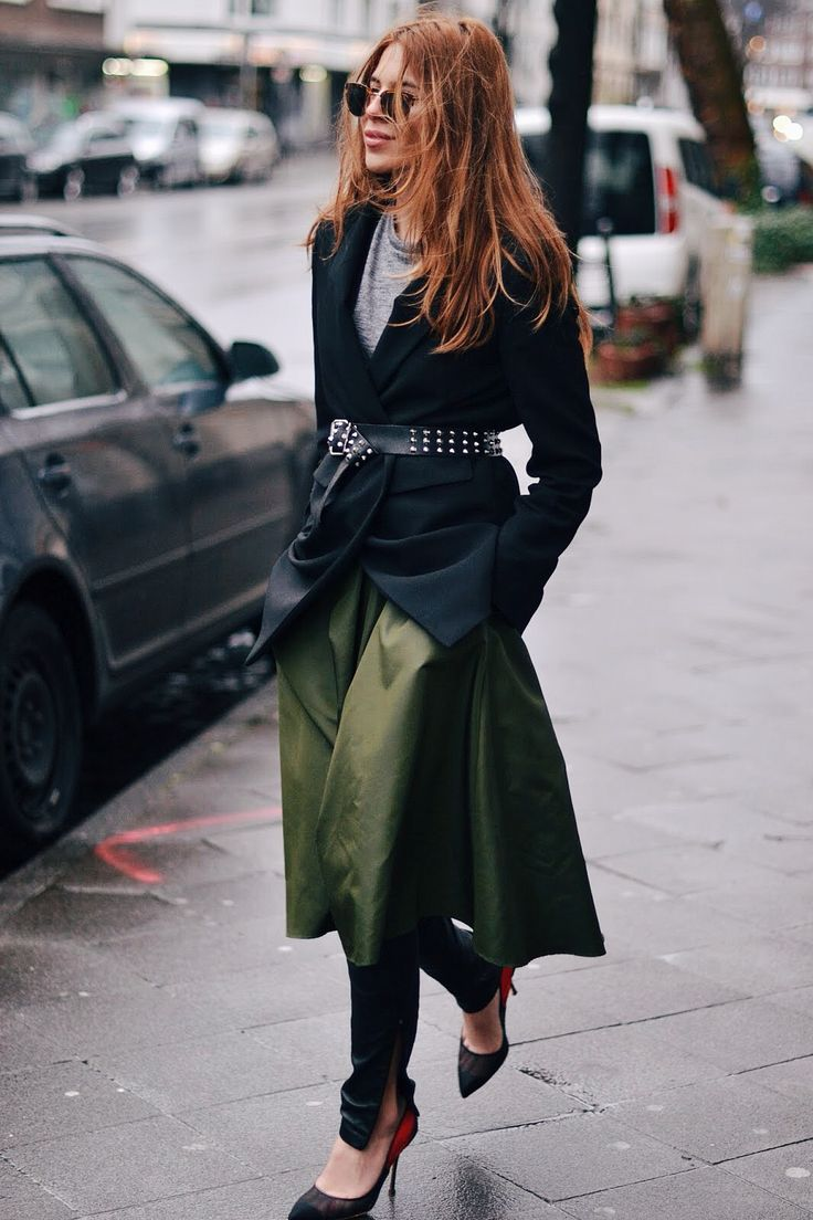 Maja Wyh is wearing an emerald green Dorothee mid length skirt over a pair of black H&M leather pants