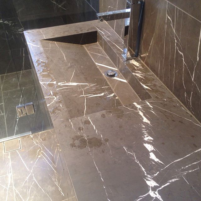 Beautiful piece of cut chocolate marble installed in a bathroom of all places... So luxe. #totalkitchens #kitchendesign #marble #bathroom #vanity
