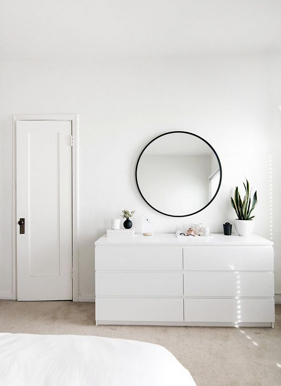 minimal bedroom design featuring our HUB MIRROR designed by Umbra co-founder, Paul Rowan.: