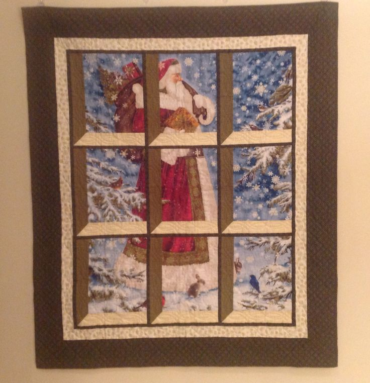 Santa is coming to Town! I made this quilt from a simple panel using the attic window pattern. Quilting was done by Linda A. Dec 2014.