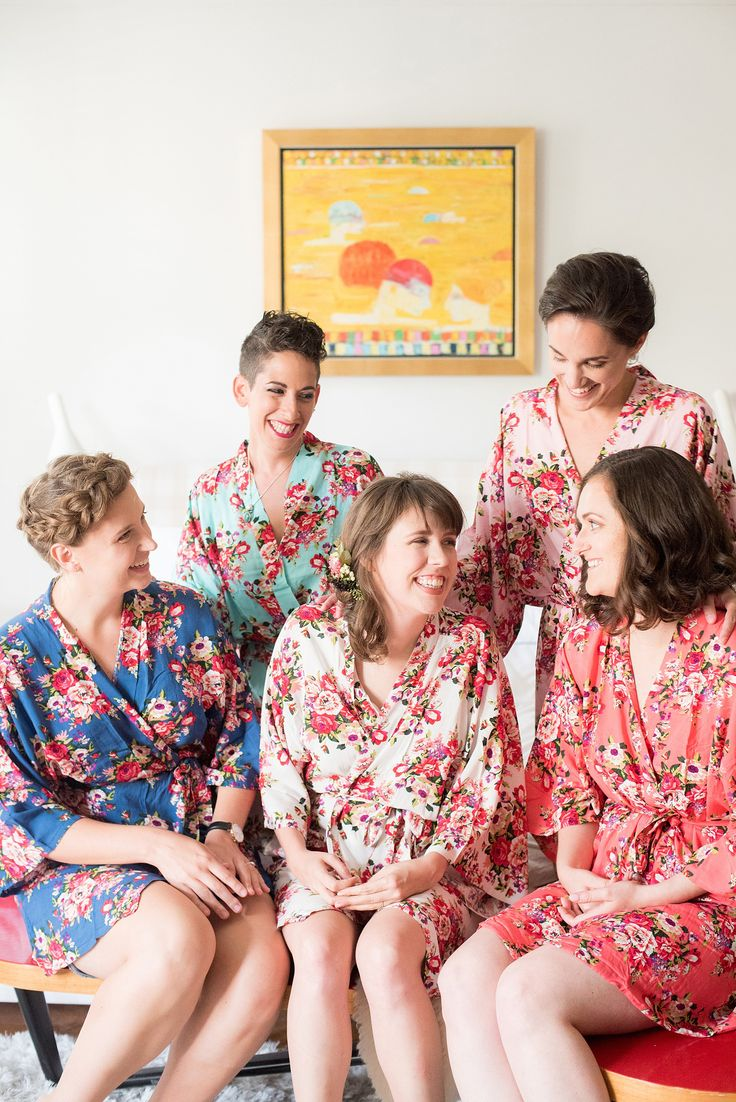 Mikkel Paige Photography photos of a wedding at Prospect Park Boathouse in Brooklyn, NY. The bride and her bridesmaids prepared in floral robes in colorful patterns.