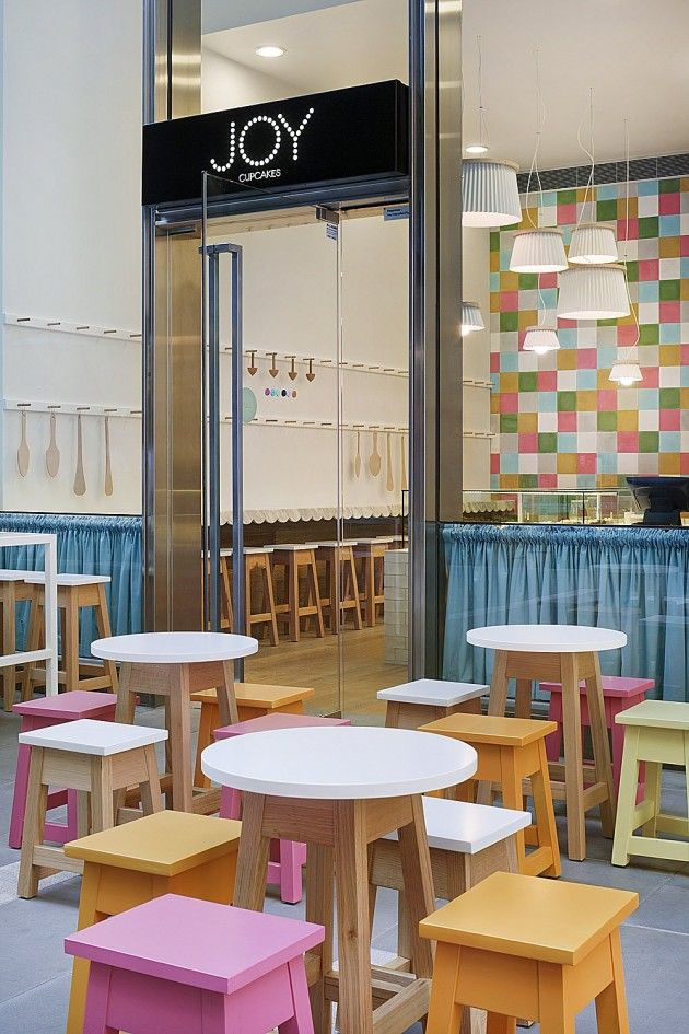 How adorable is this place?  Tasty colors and fun cupcake style light fixtures.  Sweet!  (Joy Cupcakes in Melbourne, Australia by Mim Design). Love the stools!