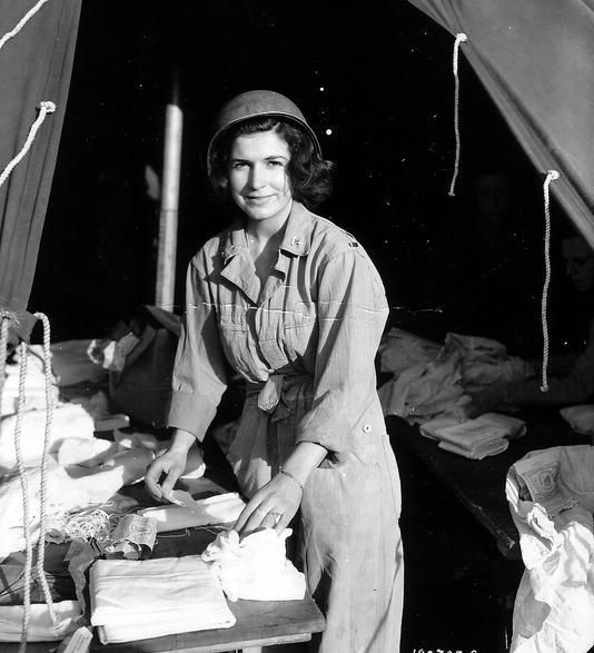 "histoire-fanatique:  "" An Army Nurse Corp at a field hospital near Omaha Beach, Normandy. Date: 12th June 1944  Photo: Conseil Régional de Basse-Normandie / National Archives USA  """