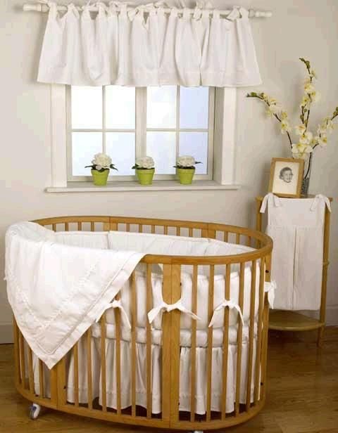 Love the round brown crib & white bedding