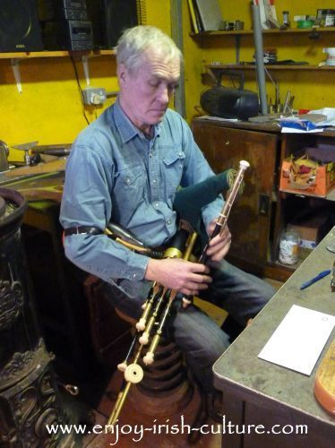 Irish music, uilleann pipes played by Irish instrument maker Eugene Lambe at his workshop in County Clare, Ireland