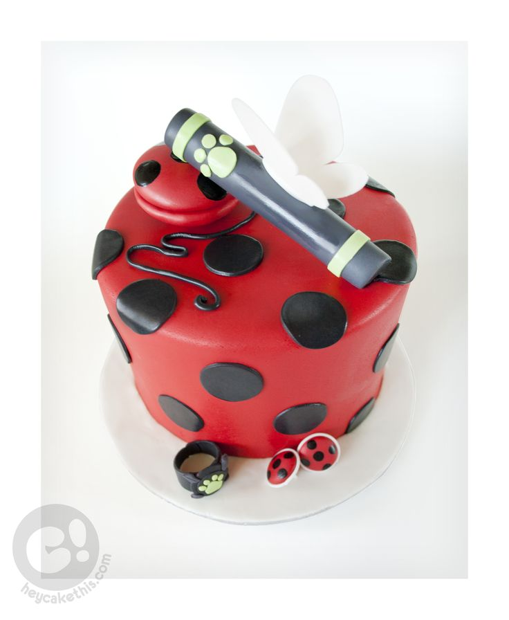 A cake themed after the cartoon Miraculous; Ladybug and Cat Noir