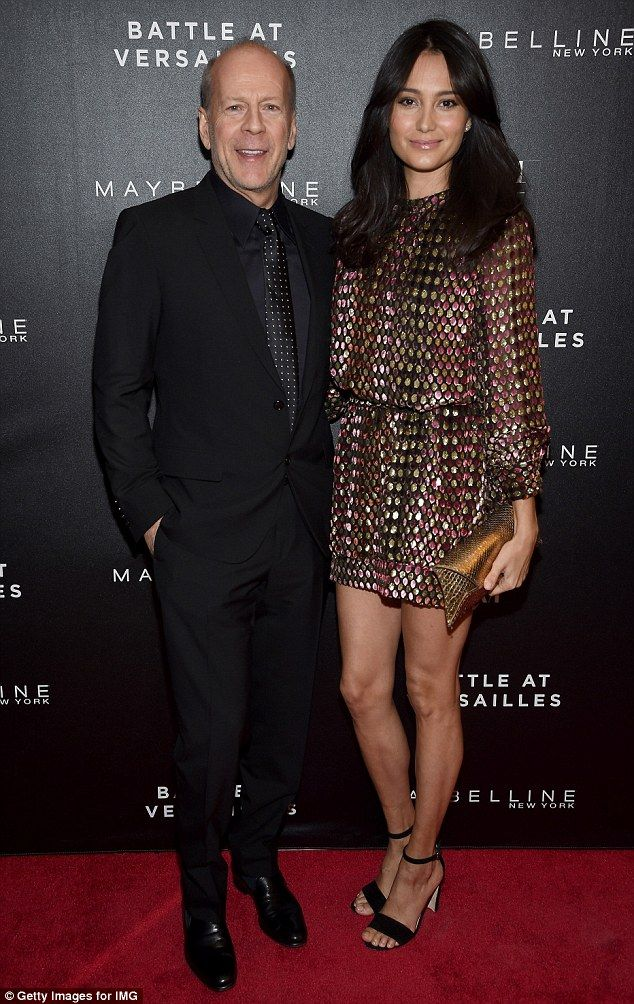 Leggy display: Bruce Willis, 60. and 37-year-old Emma Heming showed they are still dotty about each other at the Battle Of Versailles Premiere in NYC on Thursday