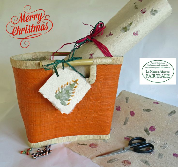 Fair Trade Christmas basket handcrafted of naturalfibres,handles of bamboo. Filled with handmade bark paper sheets, African beads of recycled plastic. A Great Christmas gift - for creativity, people and planet.