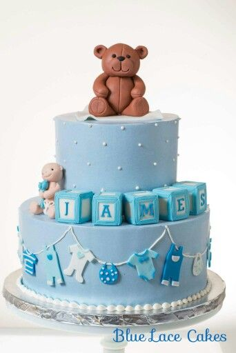Blue Lace Cakes: Blue buttercream baby shower cake with fondant teddy bear, baby blocks, and clothesline.