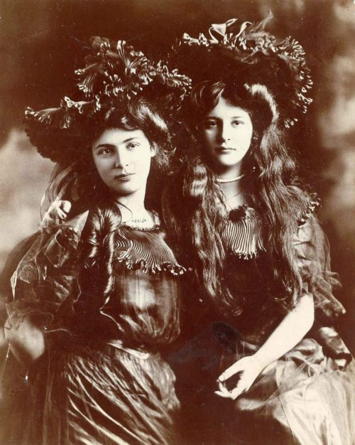 Photograph of two fashionable young ladies, likely sisters, ca. 1900.