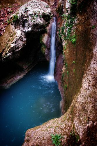 Basin Bleu is a natural waterfall located in Jacmel, Haiti. It is such a treasure that there is a maximum amount of tourists per day.