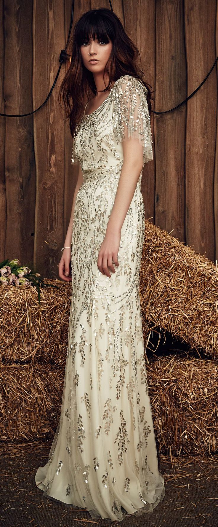 Jenny Packham Spring 2017 Hilda wedding dress with a rosemary-shaped leaf motif of appliqués from the scoop neck to the floor and fluttery, net sleeves covered in embellishment