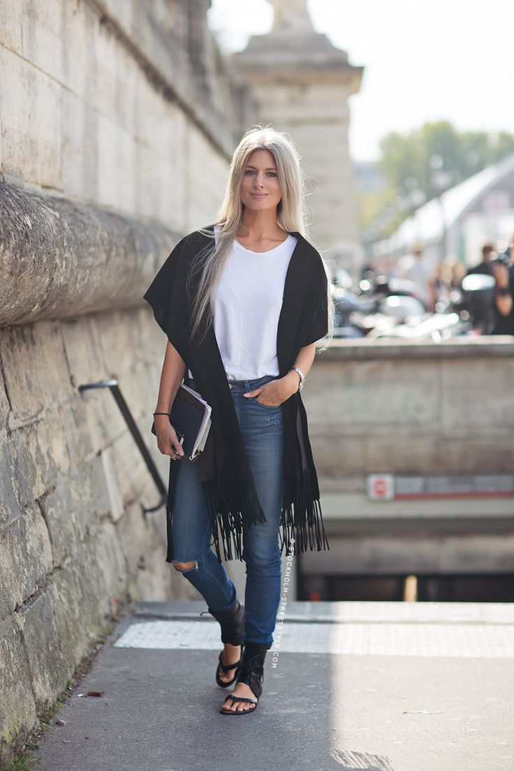 Sarah Harris wearing Valentino fringe poncho, Paige jeans, Manolo Blahnik shoes #StreetStyle