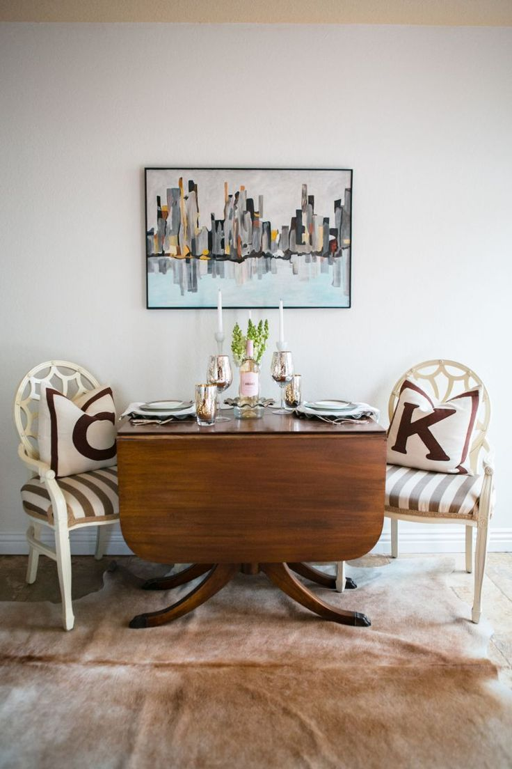 Kathleen Barnes' Orange County Home Tour #theeverygirl - white chairs with taupe and white striped seats
