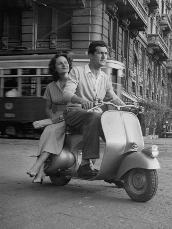 Vespa Scooter, and look how the lady is sitting:)