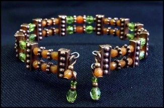 Memory wire with TierraCast / Two 'strand' bracelet - no tute but picture shows use of memory wire with spacers & dangles.  #Beading #Jewelry #Tutorials