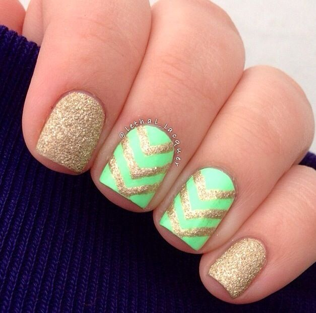 Gold chevron nails..