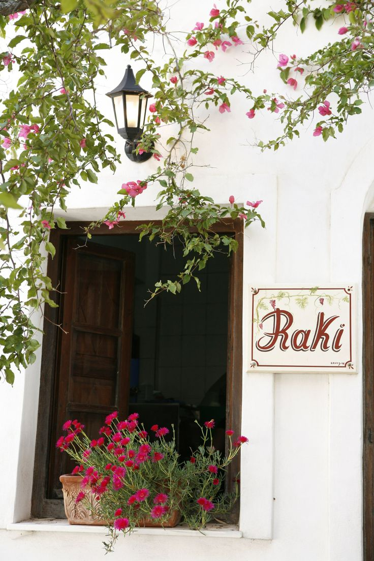 Surrounded by colorful flowers, Raki is great for some delicious small dishes, a glass of ouzo or local wine!