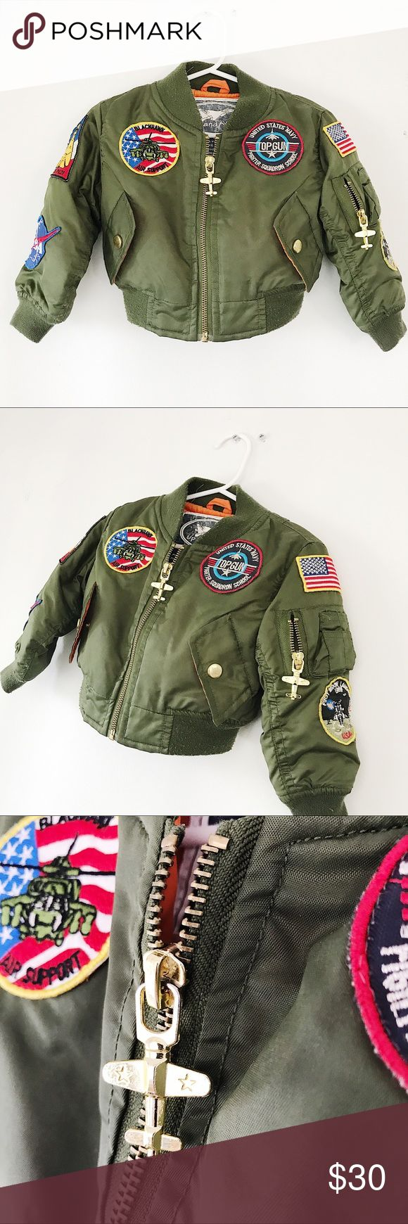 The Toddler Bomber Jacket This is unbearably cute and in great condition.  Uni-sex Fits age 10 - 18 month.  Miniaturized MA-1 Flight Jacket with Patches.  Olive green with the traditional orange lining.  Patches through out well seen on.  Gold-tone metal airplane zipper pull.  Functioning front zipper and sleeve zippers.   Jacket is traditional fall-winter bomber weight.  Moon patches, airborne patch, and more!  See pix. Up and Away Jackets & Coats