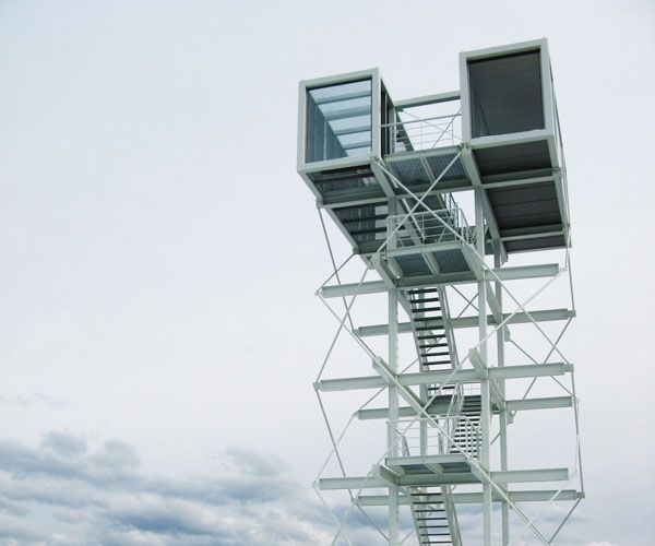 Towering Shipping Container Tea House Fuses Land and Sky
