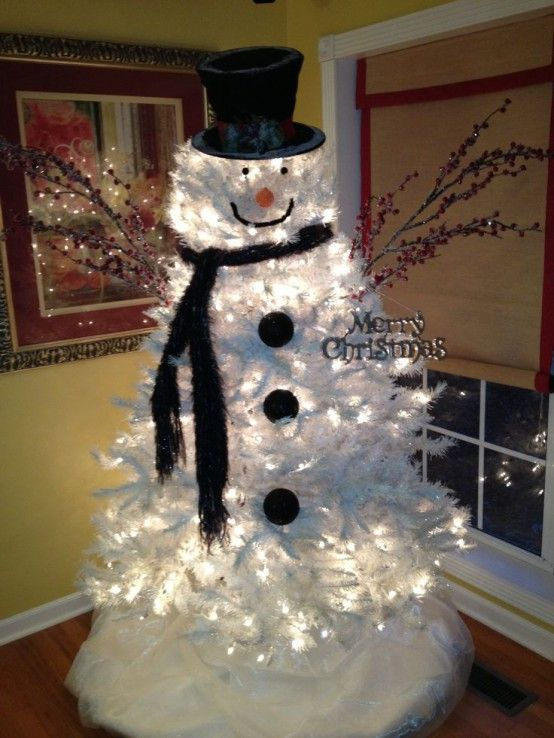 lit up silver Christmas tree turned into a snowman for a kids' room