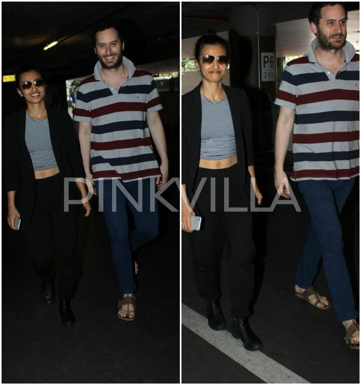 Radhika Apte and Hubby Benedict Taylor Strike a Pose At The Airport! | PINKVILLA
