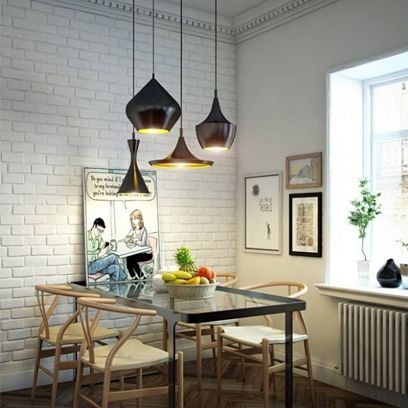 If you're lucky enough to have high ceilings, why not make lighting a real statement feature with several pendants of different shapes and sizes clustered together over a dining table.