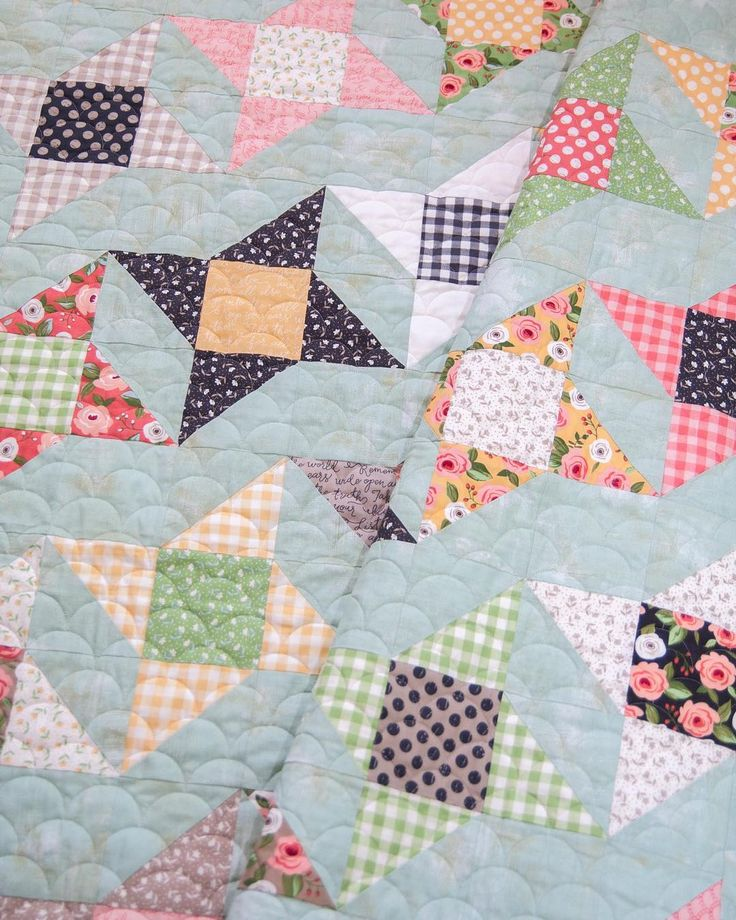 This is a Rock Star quilt pattern from the book Charm School book, remade in Farmer's Daughter fabrics + a BasicGrey grunge background (mint).