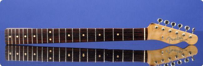 All Original December 1961 Brazilian Rosewood 'Slab Board' Telecaster Neck  1961 (December) Telecaster neck with slab-rosewood board with 21 original frets and clay-dot position markers.