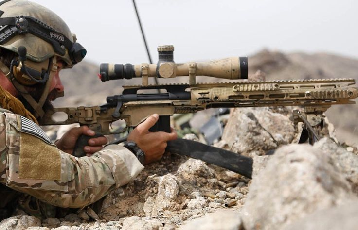 A U.S. Special Forces soldier fires a sniper rifle at enemy insurgents in Shah Wali Kot district, Kandahar province, Afghanistan, March 4, 2014. USSF assisted Afghan National Army Special Forces in creating an insurgent-free zone for newly established Afghan Local Police checkpoints in the district. (U.S. Army photo by Pfc. Dacotah Lane/Released)