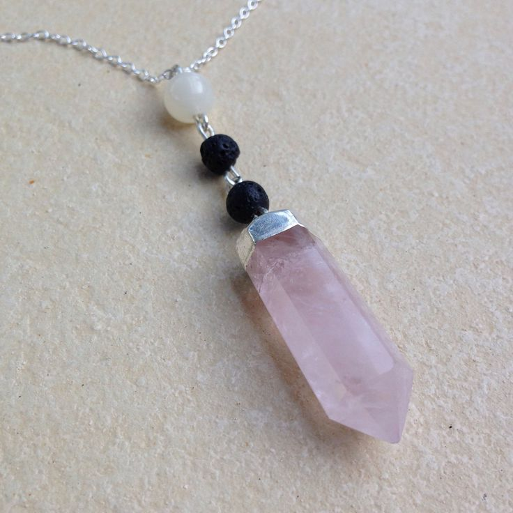 Venus necklace aromatherapy jewellery. Made with rose quartz, moonstone and lava stone. Can be used to diffuse essential oils!