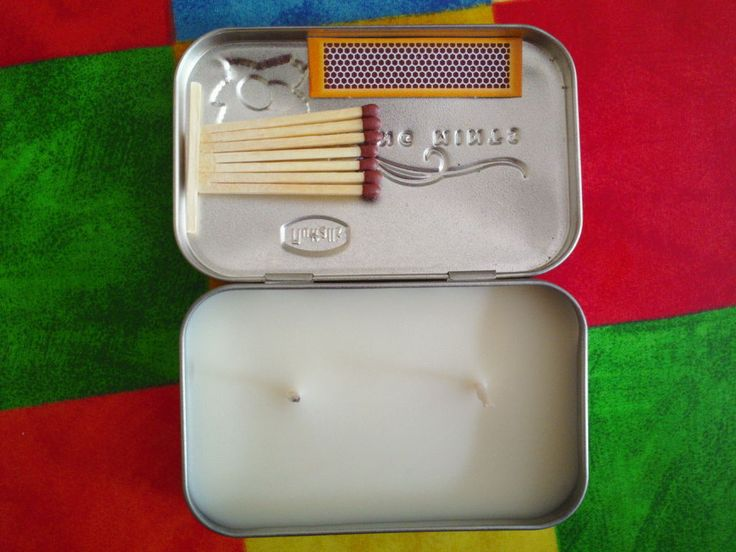 Emergency candle in a pocket tin. Melt 3 tea candles in a jar, in boiling water; removing wicks before melting if possible. Glue 2 wicks in tin, pour in wax. Glue 7 matches to 1 match stick. Then glue matches and a match book striker pad in the lid.