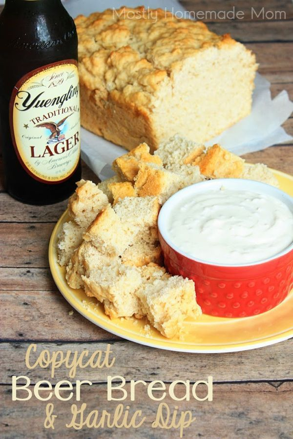 Copycat Beer Bread & Garlic Dip - Just flour, sugar, beer, and butter needed for this amazing beer bread - goes perfect with a simple garlic dip! Great for your next party!