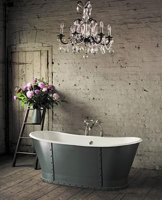 Inspiration from Bathrooms.com: Don't be afraid to mix materials in a small space: brick and tin juxtaposed with glass and chrome? Why not? It shows confidence which = glamour. #ensuitebathrooms #bathrooms #chandelier