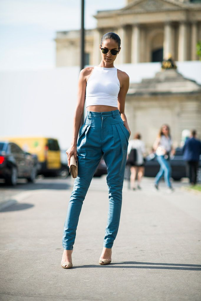 Street style: Joan Smalls wears Gucci shoes with an Alexander Wang bag, cropped top and pants...I love the pants