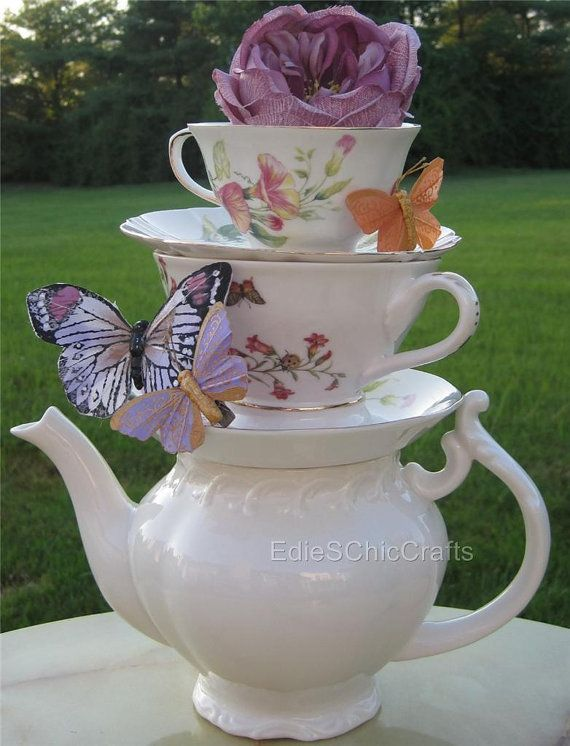 Stacked Teapot & Teacup Centerpiece - Mismatched Teacups/Saucers with butterly + floral accents - Perfect for Wedding, Shower or Tea Party via Etsy