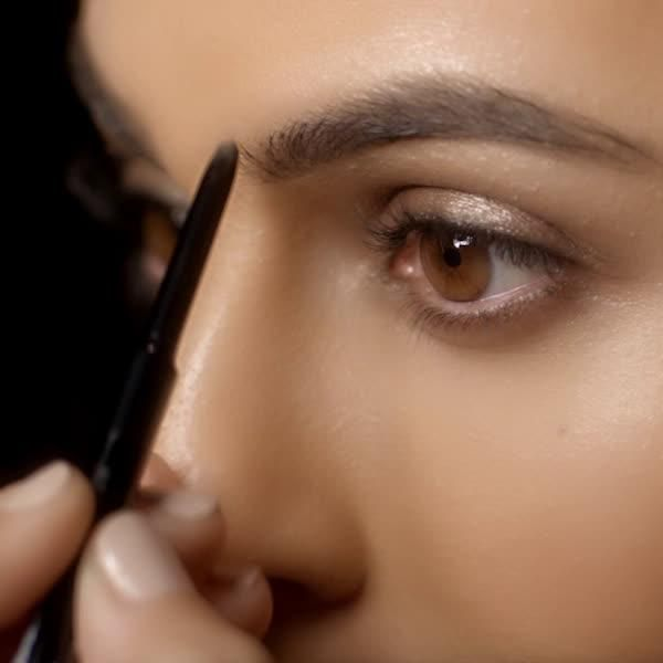 Get naturally filled brows in a New York minute using the Maybelline Brow Precise Micro Pencil. First, use brow pencil spoolie to groom brow. Then, create brow shape by drawing lines along lower arch. Fill in brow with light strokes. Next, define brow shape along top of brow and build to your preference. Finish the look by blending brow with spoolie.