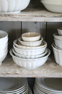 Stacks of ironstone bowls; white dishes display food best. Plus, they always match!
