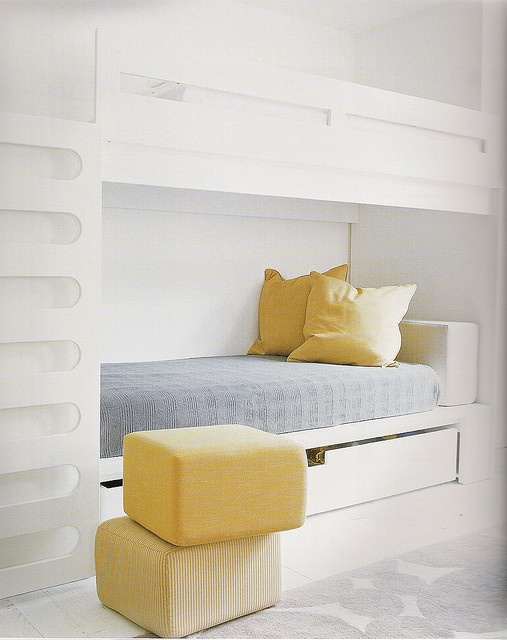 white bunk beds, lower bed conceals a slide out trundle bed for extra Guests. Use double beds and Room sleeps up to 6 people.